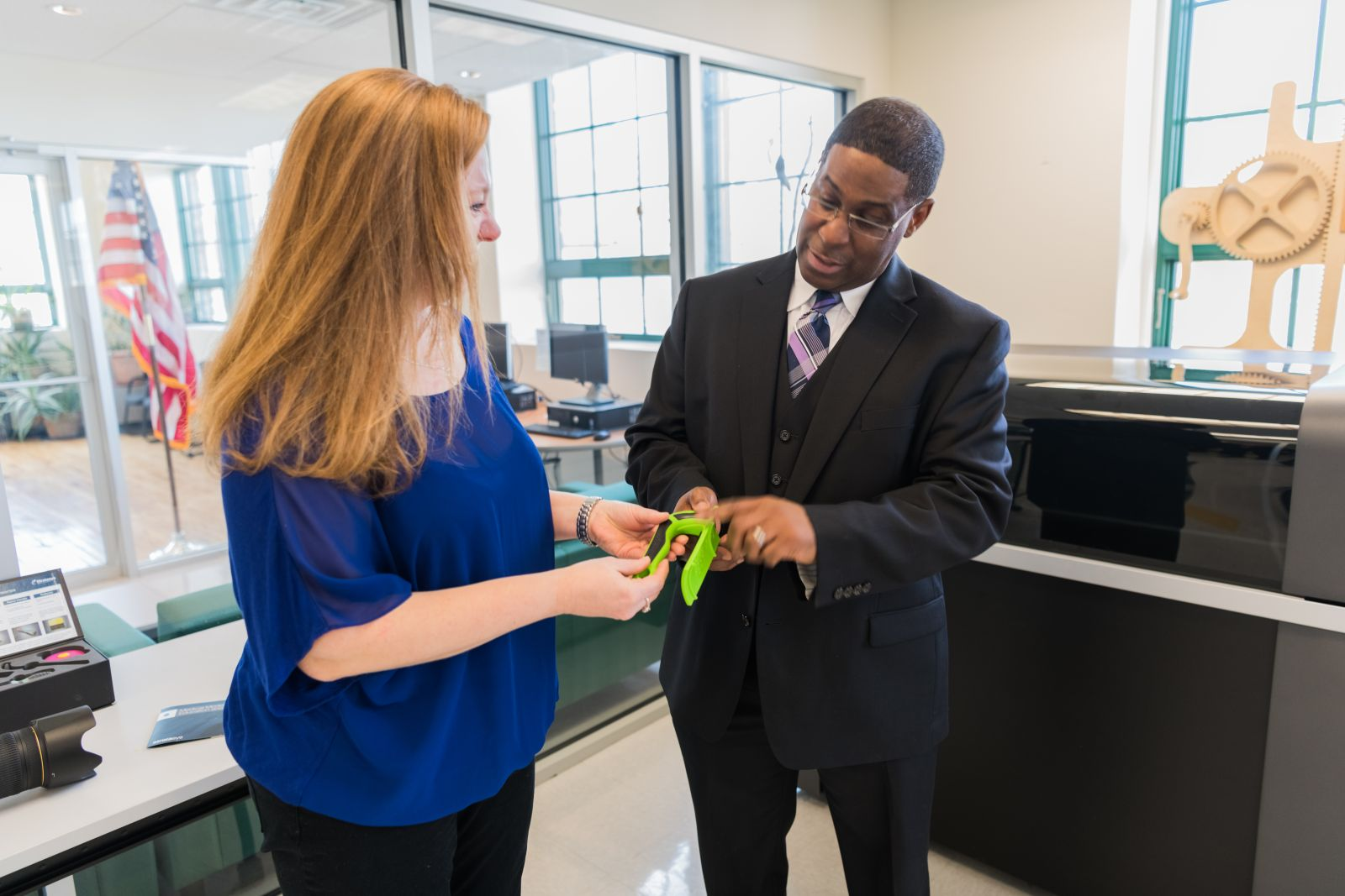Tara Payne Vallin CEO of Add A Handle shows her product to Brian Merritt, Director of The Haverstraw Center