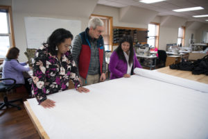 Lisa Anderson, pattern maker, Jim Melville manufacturer, and Matilde Palme Crespo, Jim's production manager, review a new design at the Hudson Valley's Fashion Incubator run by the Accelerator and located in Newburgh, N.Y.
