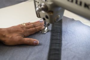 Recovering women addicts are trained on various sewing machines to make handbags. In part, by purchasing industrial machines is How T-SEC helped scale a social enterprise, Unshattered.