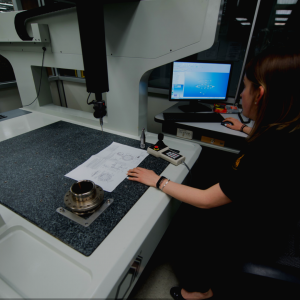 Kayla Marchand A Recent SUNY New Paltz School of Mechanical Engineering Graduate '17 sits before a T-SEC funded CMM Machine at Fala Technologies of Saugerties, N.Y. Kayla thinks Design Thinking can encourage student interest in Advanced Manufacturing.