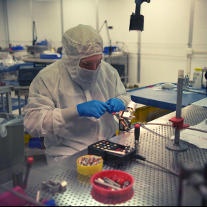 A worker at Ceres Technologies' Clean Room in Saugerties, N.Y. The clean room has an advanced filtering system so technicians can work at the nanoscale required in advanced manufacturing in the Hudson Valley.